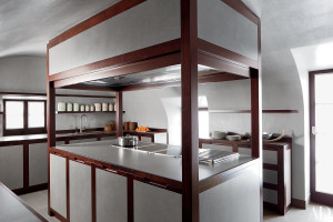 Giorgio Armani's kitchen in his Switzerland residence, conceived in collaboration with Molteni, boasts mahogany detailing and Venetian plaster.