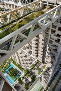 The two lower sky bridges are lined with trees and chairs for residents of the building to enjoy.