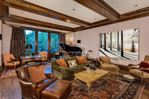 Wood ceiling beams and flooring create warmth in the family room.