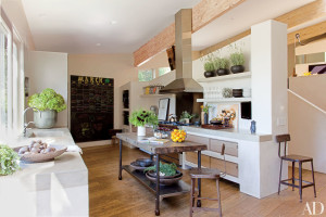 At Jillian and Patrick Dempsey's Malibu, California, home devised by Estee Stanley Interior Design, the kitchen features a concrete sink and countertops as well as a Wolf range and a Best hood.